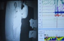Split screen - Sleep laboratory bedroom and polysomnogram.
