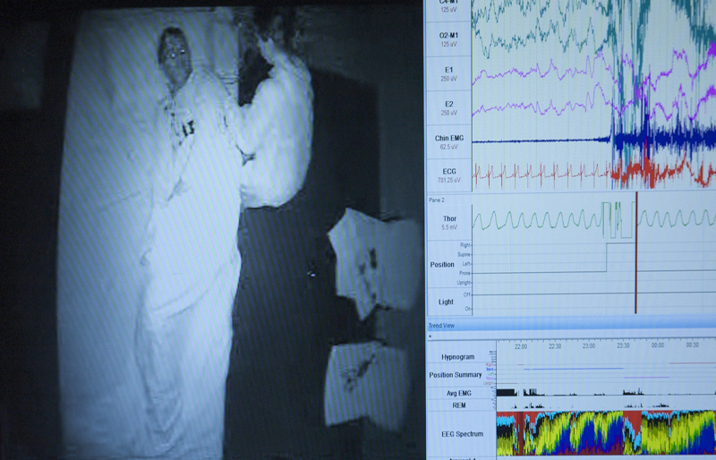 Split screen - Sleep laboratory bedroom and polysomnogram.