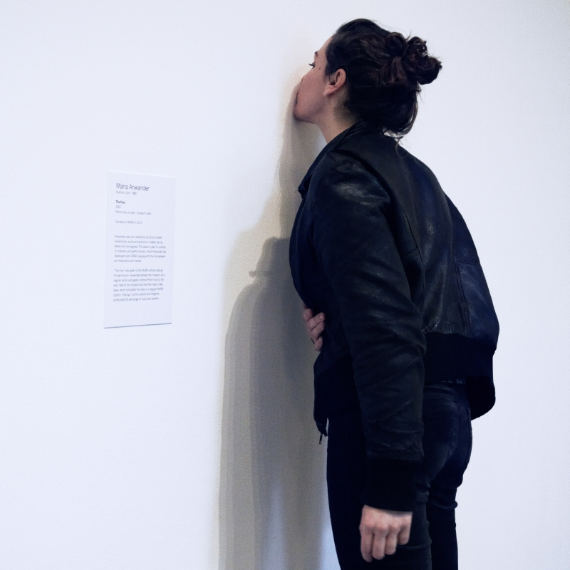 The Kiss, 2007–2010, Maria Anwander. French kiss on wall and museum label.